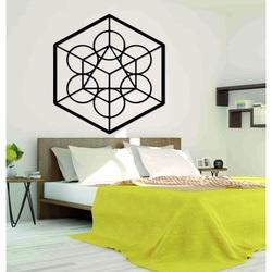 Drewniany obraz geometryczny na ścianie żniwa